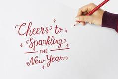 Приветственные восклицания к сверкная слову Новых Годов Стоковое фото RF