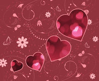 Приветствия дня валентинок Расплывчатые красные сердца и спиральный цветочный узор Стоковая Фотография