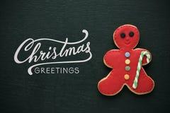 Приветствия рождества печенья и текста рождества Стоковые Изображения RF