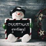 Приветствия рождества снеговика и текста Стоковые Изображения