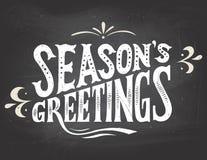 Приветствия сезона на предпосылке доски Стоковые Изображения