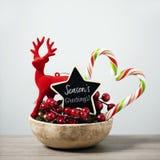 Приветствия сезонов орнаментов и текста рождества стоковое изображение rf