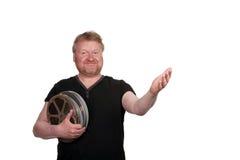 Приветствующий человек, держа вьюрки фильма стоковые изображения