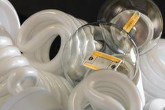 2 привели шарик среди много ламп CFL Стоковая Фотография
