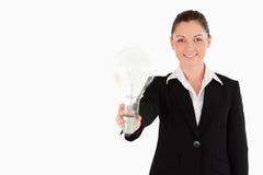 привлекательная женщина костюма света удерживания шарика Стоковая Фотография RF