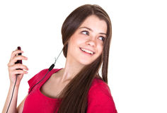 привлекательная девушка слушает усмехаться нот предназначенный для подростков Стоковые Фото