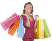 привлекательное удерживание несколько детенышей женщины shoppingbag стоковые фотографии rf