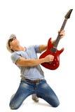 привлекательный играть музыканта гитары Стоковая Фотография
