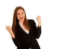 Привлекательный молодой успех жеста бизнес-леди над wh Стоковое Фото