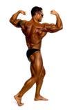 Привлекательный строитель мыжского тела, демонстрируя представление состязания Стоковая Фотография RF