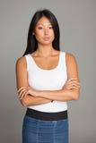 Привлекательная азиатская девушка в юбке джинсов Стоковые Фотографии RF