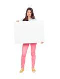 Привлекательная девушка с пустым плакатом Стоковое фото RF