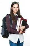 Привлекательная жизнерадостная молодая студентка держа книги, изолированные на белой предпосылке Стоковая Фотография RF