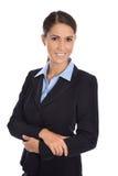 Привлекательная изолированная усмехаясь коммерсантка в голубом костюме Стоковые Фотографии RF