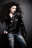 Девушка в кожаной куртке Стоковая Фотография