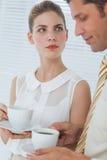 Привлекательная коммерсантка смотря ее коллеги Стоковое Изображение RF
