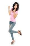 Привлекательная молодая счастливая женщина подняла ее руку Стоковое Изображение