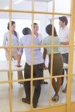 Привлекательные бизнесмены говоря друг с другом Стоковые Фото