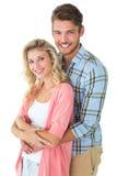 Привлекательные молодые пары усмехаясь на камере Стоковое Фото
