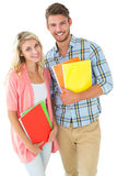 Привлекательные пары студента усмехаясь на камере Стоковое фото RF