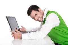 Привлекательный изолированный бизнесмен имеет проблемы компьютера. Стоковые Изображения