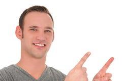 Сь молодой человек указывая вверх Стоковое Фото