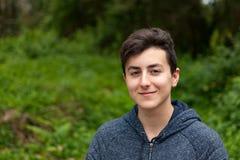 Привлекательный парень подростка в парке Стоковая Фотография RF