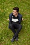 Привлекательный парень подростка в парке Стоковые Фото