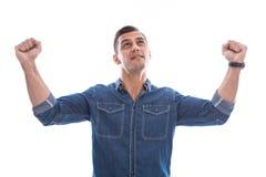 Привлекательный победитель с руками вверх. стоковая фотография