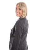 Привлекательный созрейте изолированная белокурая женщина в обмундировании дела стоковые изображения