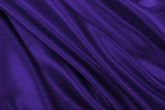 Приглаживайте элегантную текстуру ткани шелка или сатинировки сирени роскошную как abstr Стоковое Изображение