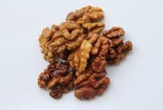 Пригорошня грецких орехов стоковые изображения