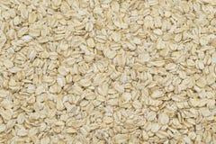 Пригорошня зерен коричневого риса на белой предпосылке стоковые изображения rf