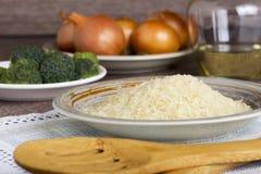 Пригорошня зерен риса стоковое изображение