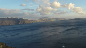 приготовьте сигнал над деревней oia на острове santorini акции видеоматериалы