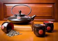 придает форму чашки чайник Стоковые Фото