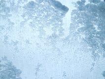 Придерживаемый снег на ясном стекле Стоковые Фотографии RF