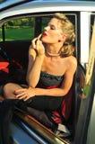 прикладывать женщину красного цвета губной помады Стоковые Фото