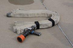 прикреплено пожарный рукав случая непредвиденный подготовленный огородить был Стоковая Фотография RF
