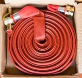прикреплено пожарный рукав случая непредвиденный подготовленный огородить был Стоковое Изображение