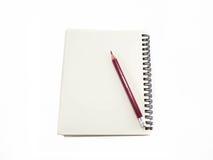 прикройте карандаш тетради Стоковая Фотография RF