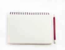 прикройте карандаш тетради Стоковые Изображения RF