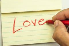 Примечание влюбленности сочинительства руки Стоковые Фото