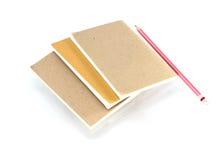примечание изолированное книгой Стоковое фото RF