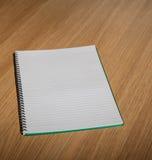 примечание изолированное книгой Стоковая Фотография RF