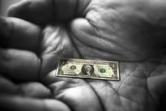 примечание руки доллара Стоковое Изображение