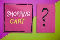 Примечание сочинительства показывая магазинную тележкау Бакалеи и товар нося вагонетки случая фото дела showcasing стоковые изображения