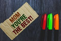 Примечание сочинительства показывая маме вас re благодарность самого лучшего фото дела showcasing для вашей карточки комплимента  стоковые фото