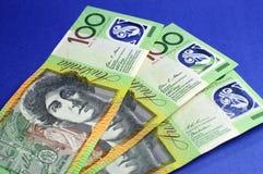 300 примечаний доллара на голубой предпосылке Стоковое фото RF