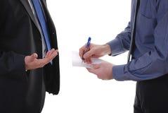 примечания бизнесмена пишут Стоковое Изображение